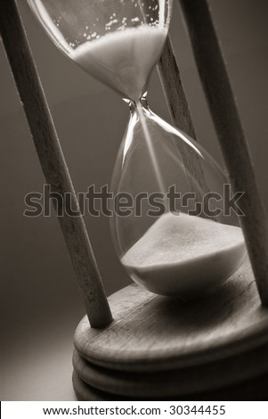 time concept with old hourglass - stock photo