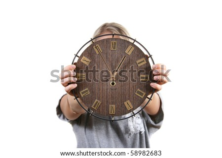 time concept: woman hold clock in front of face