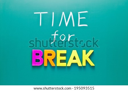 Time For A Break Concept on green blackboard - stock photo