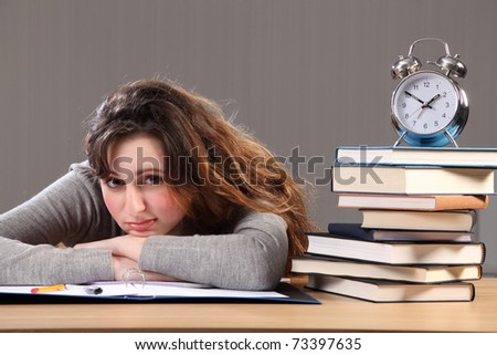 Time for a break for young caucasian student girl doing her homework.. - stock photo