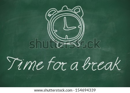 Time for a break written with chalk on blackboard - stock photo