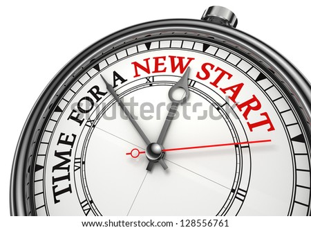 time for a new start concept clock closeup on white background with red and black words