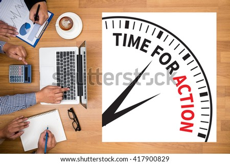 TIME FOR ACTION Business team hands at work with financial reports and a laptop - stock photo