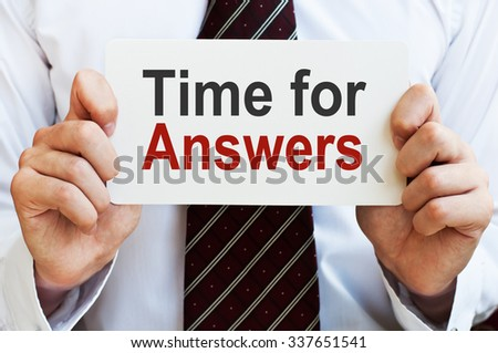Time for Answers. Business concept written on a card in a hand of businessman - stock photo