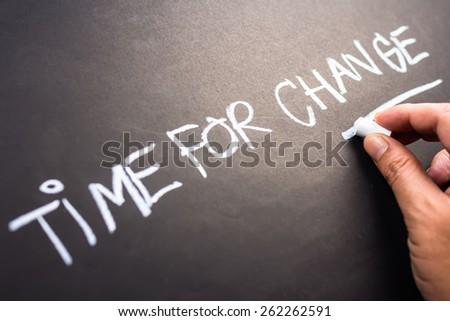 Time for Change, closeup hand writing on blackboard - stock photo