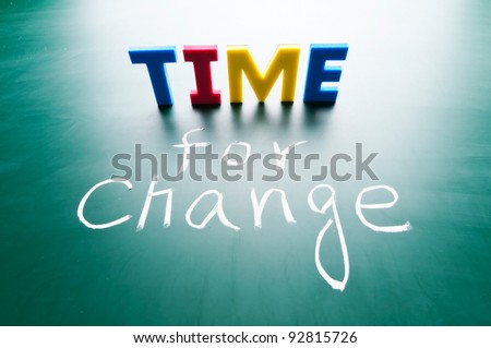 Time for change, colorful words on blackboard. - stock photo