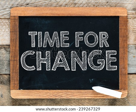 Time for change handwritten with white chalk on a blackboard - stock photo