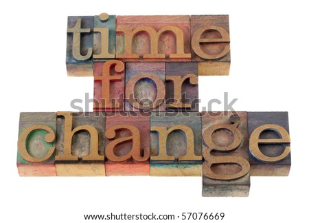 time for change headline words in vintage wooden letterpress type blocks, stained by color ink, isolated on white - stock photo
