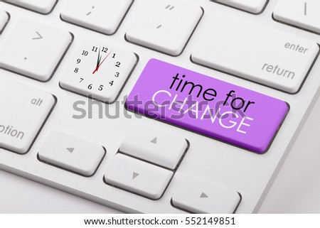 Time for change written on computer keyboard.