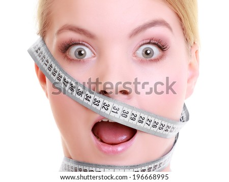 Time for diet slimming weight loss. Health care healthy lifestyle. Fit fitness woman with gray measure tapes around her head. Obsessed girl by body isolated - stock photo