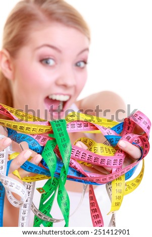 Time for diet slimming weight loss. Health care healthy lifestyle. Sport fitness woman fit girl holding a lot of colorful measure tapes isolated on white - stock photo