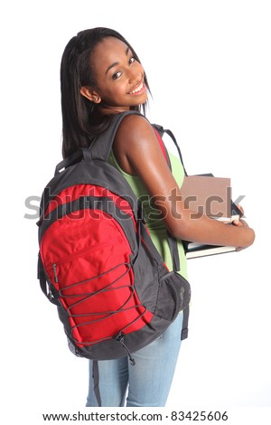 Time for education from pretty young African American teenager high school student girl with big beautiful smile wearing red backpack and holding study books. - stock photo
