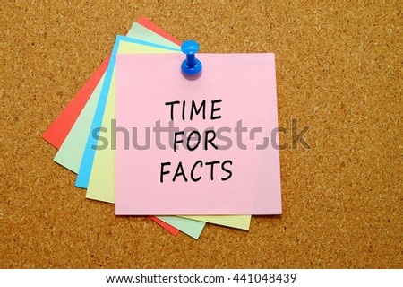 Time for facts written on color sticker notes over cork board background.