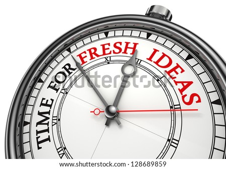 time for fresh ideas concept clock closeup on white background with red and black words