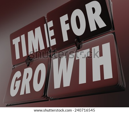 Time for Growth words on clock with flipping tiles to remind you now is the moment to improve, rise or increase toward achieving progress, success and goals - stock photo