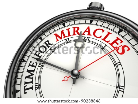 time for miracles concept clock closeup on white background with red and black words