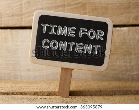 Time For New Content, handwriting on chalkboard - stock photo