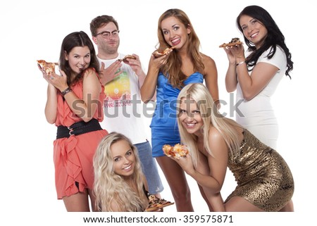 Time for pizza! Group of young people eating pizza. studio shoot