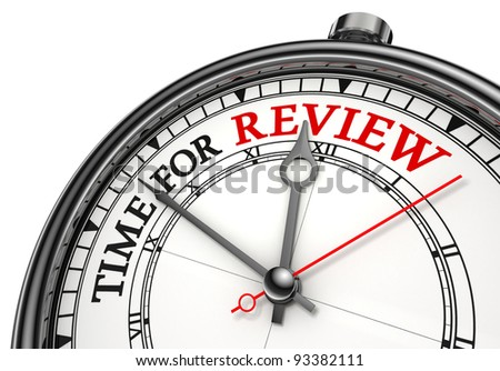 time for review concept clock closeup on white background with red and black words - stock photo