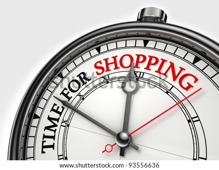 time for shopping concept clock closeup on white background with red and black words