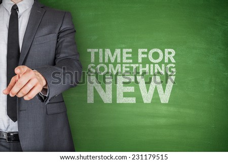 Time for something new on blackboard with businessman - stock photo