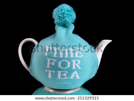 Time for tea kettle on black - stock photo