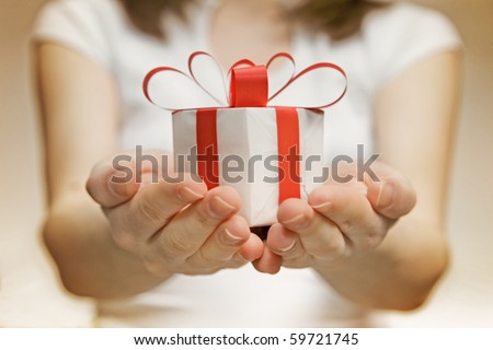 Time gifts - gift box in hand girls - stock photo