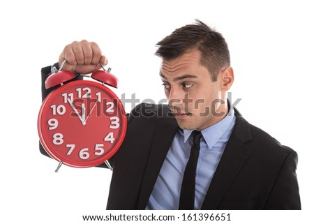 Time is money : businessman holding up red alarm clock isolated on white background - stock photo