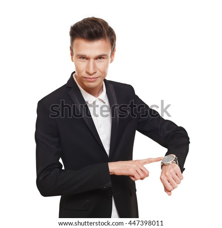 Time is money. Businessman point finger at his watch showing that it is late, hurry up, check the time. Man in suit isolated at white background. - stock photo
