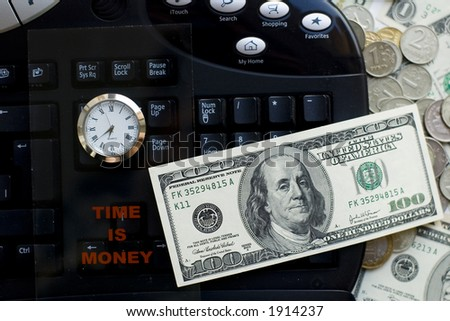 Time is money- clock, keyboard and dollars