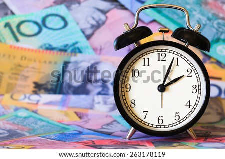 Time is money, clock on cash australian dollar bill pattern background australian dollars. business Commerce concept - stock photo