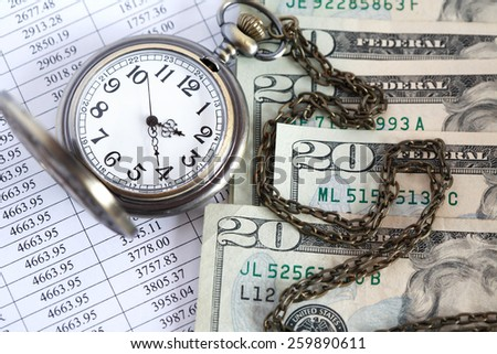 Time is money. Closeup of dollar bank notes near open pocket watch on paper list with digits - stock photo