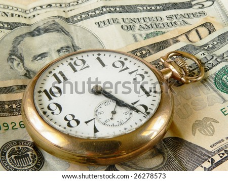 time is money concept of cracked and dusty antique pocket watch on US currency - stock photo