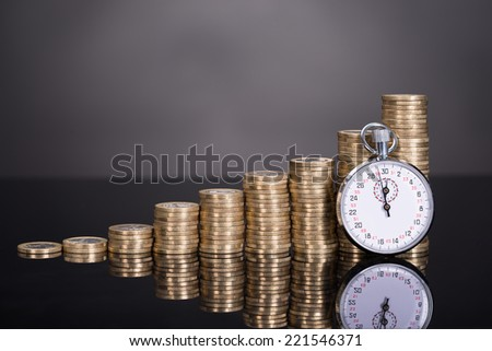 Time is money concept over black background - stock photo