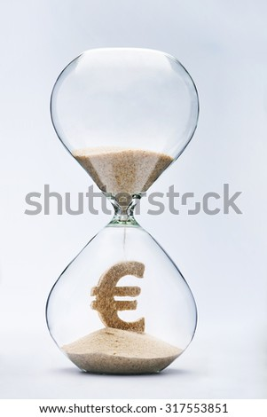 Time is money concept with falling sand taking the shape of a euro - stock photo