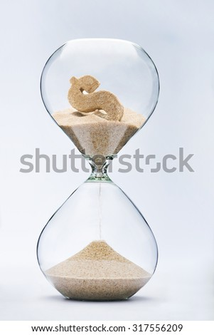 Time is money. Dollar sign flowing down in the hourglass. - stock photo
