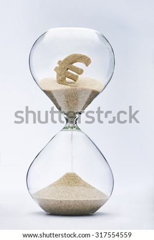 Time is money. Euro sign flowing down in the hourglass. - stock photo
