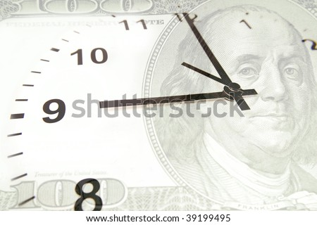 Time is money financial concept. Clock on U.S. hundred dollars. - stock photo