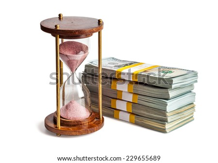 Time is money loan debt deadline concept background - hourglass and stack of new 100 US dollars 2013 edition banknotes (bills) bundles isolated on white - stock photo