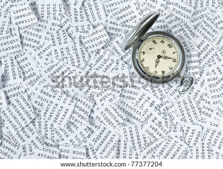 Time is passing by - pocket watch on a tore DNA sequence - stock photo