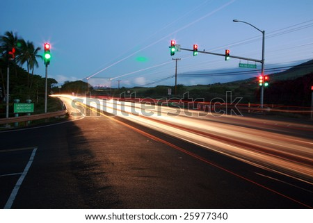 "time laps aka bulb exposure of the ""Honoapi'ilani Highway"" on maui hawaii - stock photo"