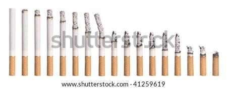 Time lapse - Burning cigarette isolated on white - stock photo