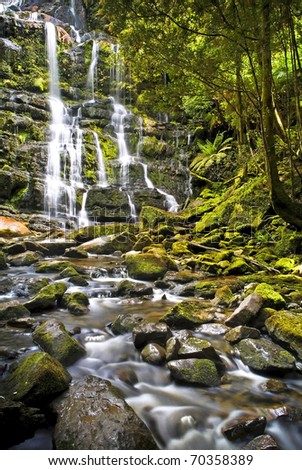 Time-lapse waterfall and lush forest - stock photo