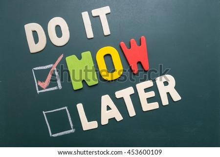 Time management concept - business concept - Do It Now or Later with checkbox and red marking on blackboard