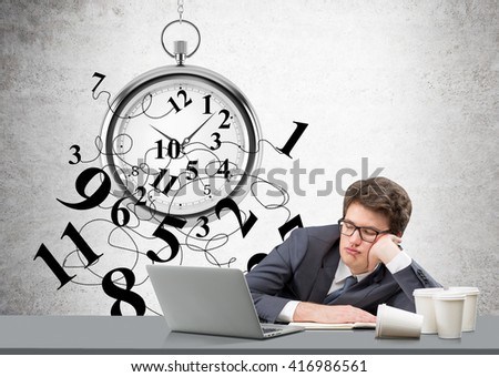 Time management concept with broken clock and sleepy businessman at desk with laptop and various coffee cups - stock photo
