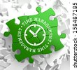 Time Management with Icon of Clock Face Written on Green Puzzle Pieces. Business Concept. - stock photo