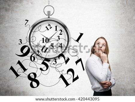 Time management with thoughtful businesswoman and broken clock - stock photo