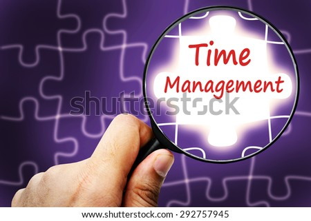 Time management  word. Magnifier and puzzles. - stock photo