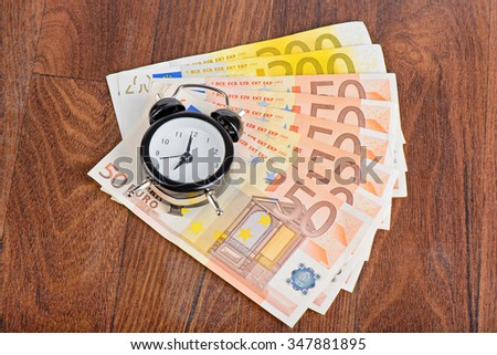 Time - money. Business concept. Alarm clock on the 50 Euro banknotes  - stock photo