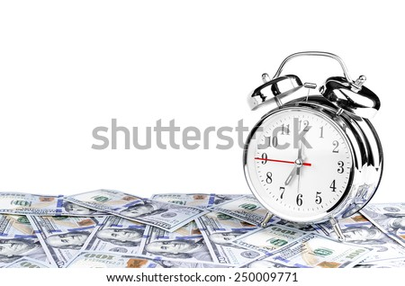 Time - money. Business concept. Analog hours on a heap of paper dollars - stock photo